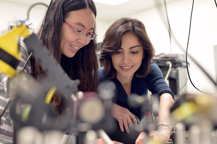 Female student and professor work together in a lab