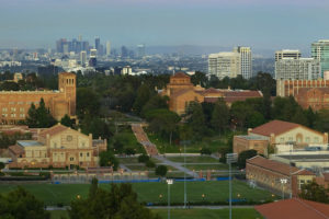 Wide angle photograph of the UCLA campus with the city of Los Angeles and mountains in the background