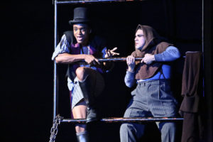 Two students performing in a stage production