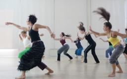 Women participate in a dance class.