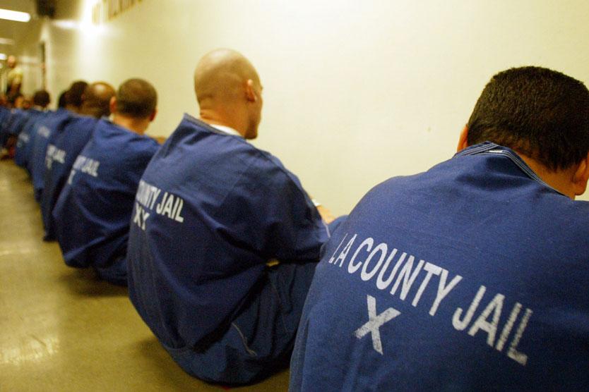 Backs of inmates sitting in LA County jail.