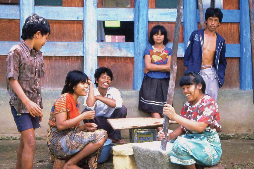 Indigenous Lake Tabo region men and women, Indonesia