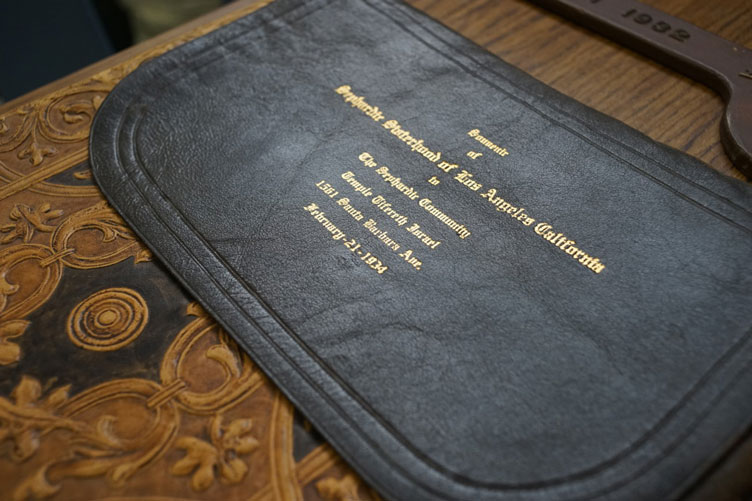 """Leather pouch gold-stamped with """"Sephardic Sisterhood of Los Angeles California"""" and other details"""