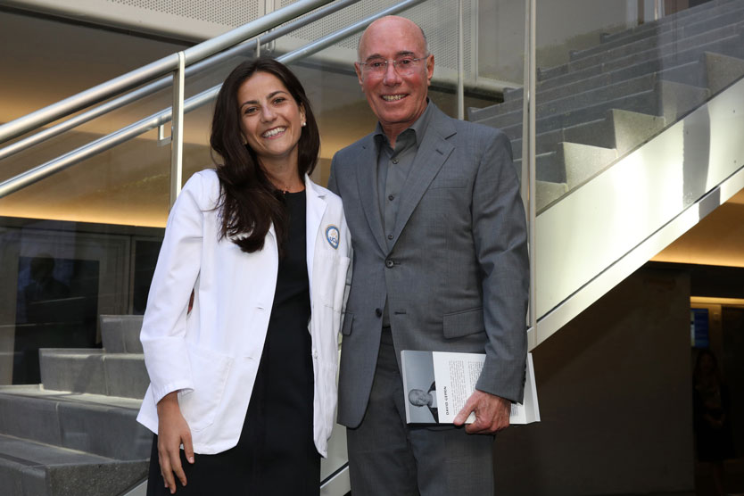 Med student and David Geffen pose together in Geffen Hall