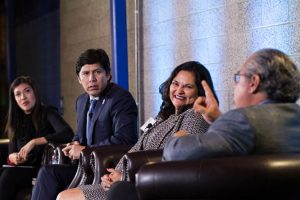 Lucy Flores (far left) moderates a discussion among a group of panelists — Kevin de León, Laura E. Gómez, and Gary Segura (left to right)