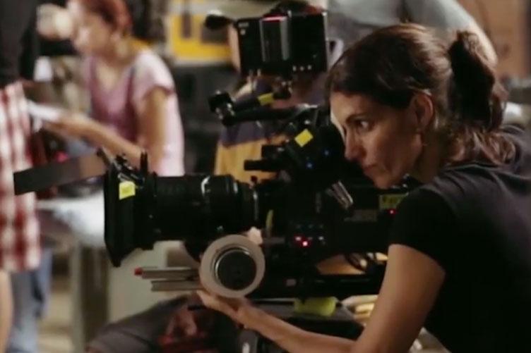 Female Arab film maker using camera