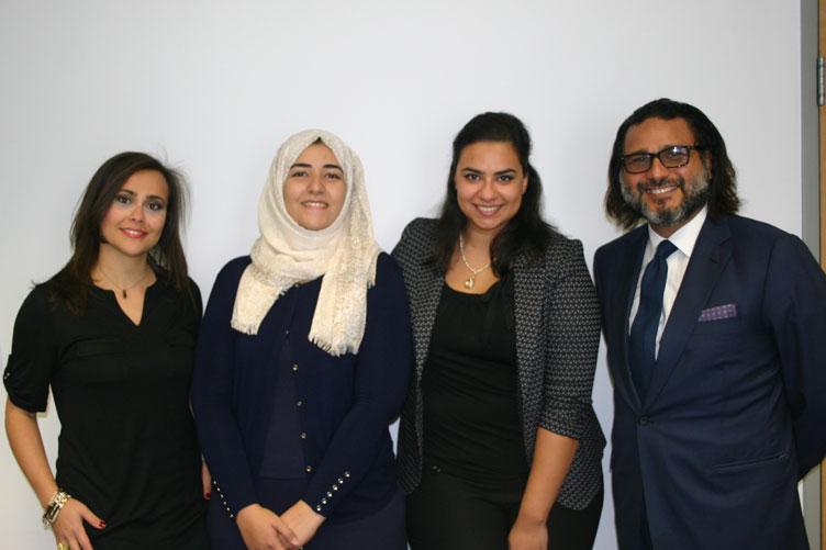 Three Arab film students with donor Hani Farsi