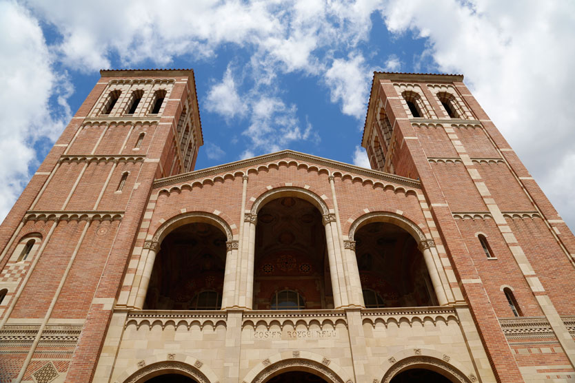 Image of Royce Hall, looking up at blue sky with clouds
