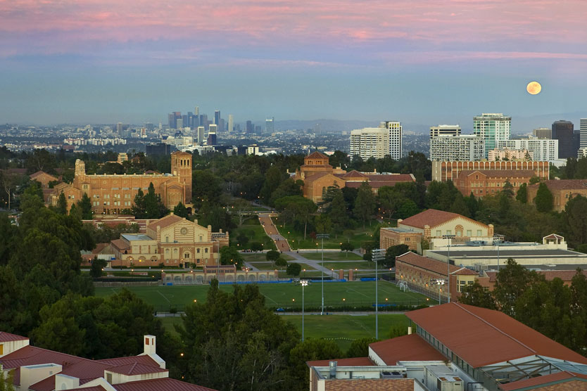 panoramic view of UCLA looking eastward across the intramural fields, with downtown L.A. in the background, at twilight